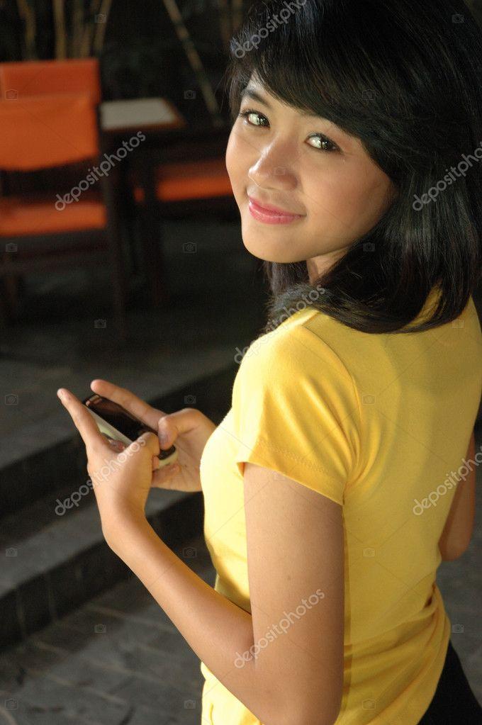 Teenage girl wearing yellow shirt — Stock Photo ...