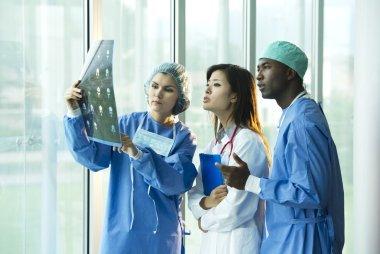 Multi-ethnic doctors consulting
