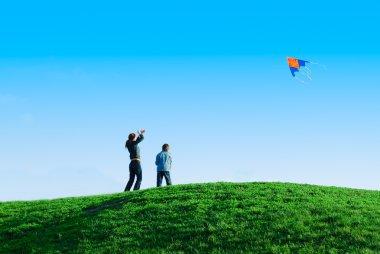Family playing kite