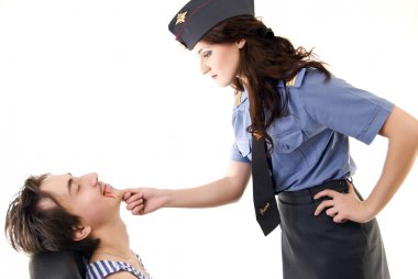 Young woman in police uniform and a criminal