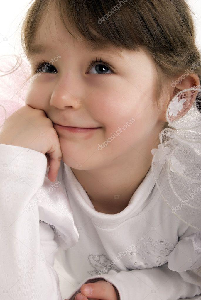 Beautiful little girl thinking