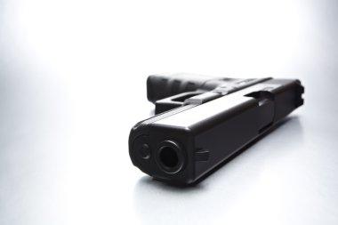 Handgun closeup on cold highkey brushed metal background stock vector
