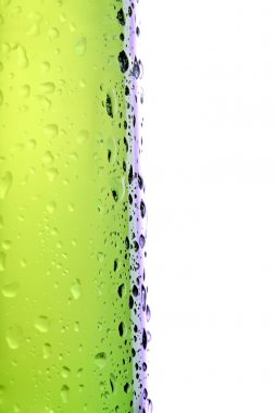 Beer bottle side view, macro with water droplets isolated on white stock vector