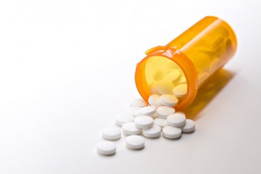 Aspirin medicine with bottle on white