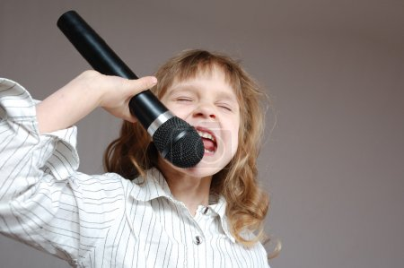 Singing child with a microphone