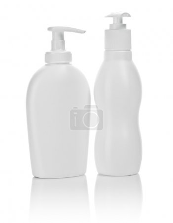 Two white cosmetical bottles isolated