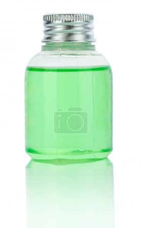 Transparent plastical bottle with green liquid