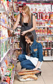 Two women choose food
