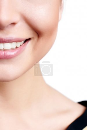 Smiling woman mouth with great teeth. Over white background