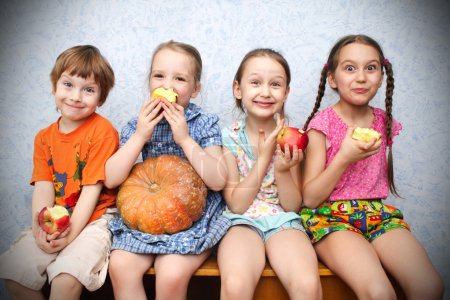 Photo for Group of preschool children to eat apples - Royalty Free Image