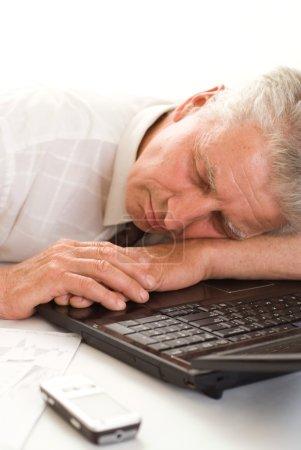 Bisnessman sleeping on a laptop