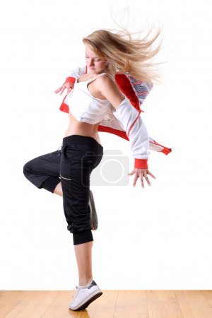 Woman modern ballet dancer in ballroom
