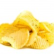 Handful of yellow potato chips isolated on white b...