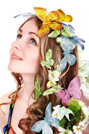 Girl with butterfly and flower on head