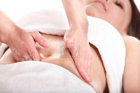 Beautiful girl having stomach massage.
