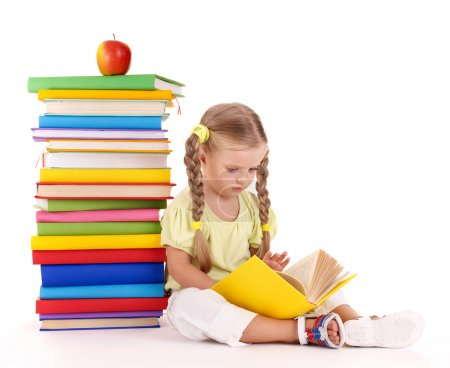 Photo for Little girl sitting on pile of books. Isolated. - Royalty Free Image