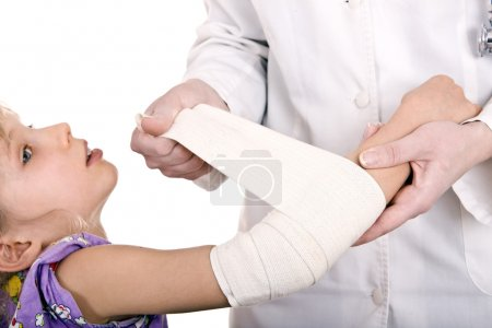 Doctor give first aid of child.