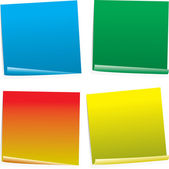 Four color post it notes in different styles and angles