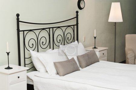 The forged headboard of bed with pillows