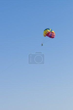 Man flies to parachute