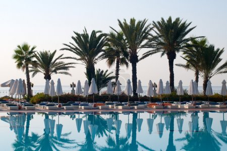 Photo for Poolside lounge in seaside resort in the morning - Royalty Free Image