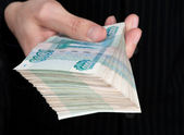 Hand holding boundle of roubles