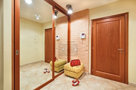 Elegance anteroom interior in warm tones with hall...