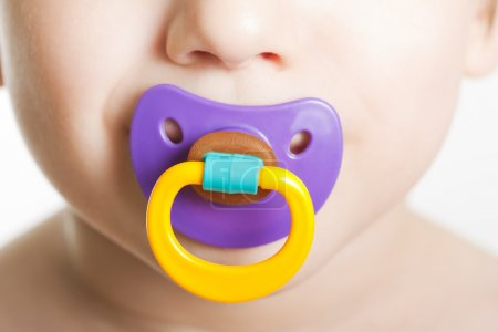 Child with baby pacifier
