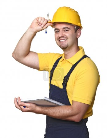Photo for Smiling handyman with notebook isolated on white background - Royalty Free Image