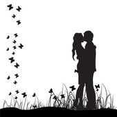 Couple kisses on a meadow black silhouette