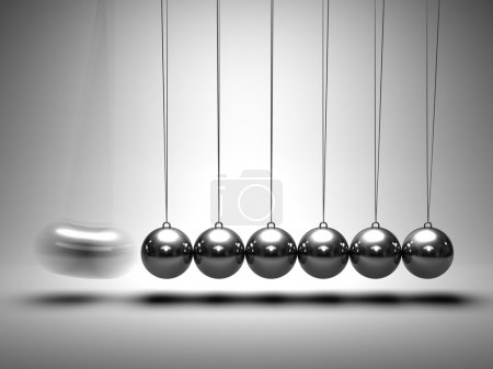 Photo for Balancing balls Newton's cradle on grey background - Royalty Free Image