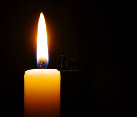 Photo for Burning candle isolated on black background - Royalty Free Image