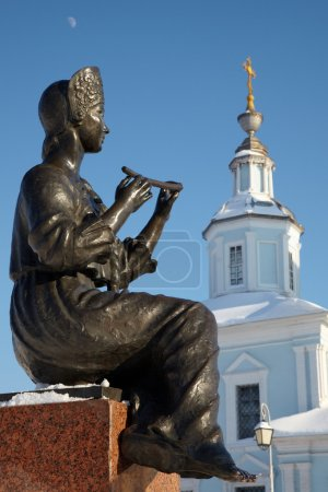 Statue of girl playing flute
