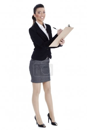 Full length of business woman writing