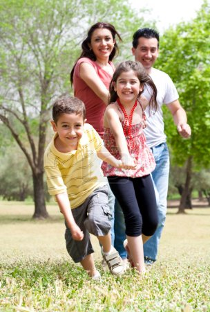 Photo for Happy family having fun in the park,outdoor - Royalty Free Image
