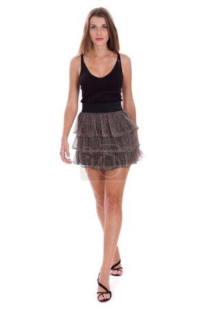 Foto de Longitud total de una joven hermosa modelo posando, sobre fondo blanco - Imagen libre de derechos