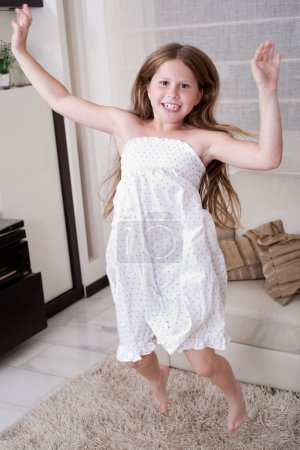 Young little girl jumping