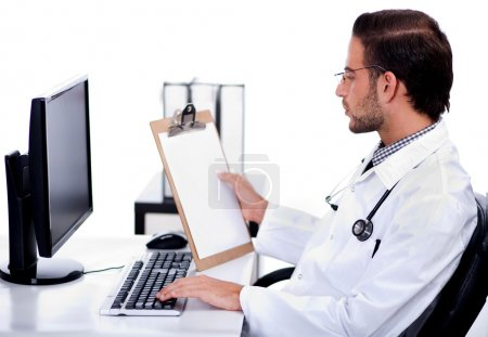 Young ethnic doctor looking at medical report deeply