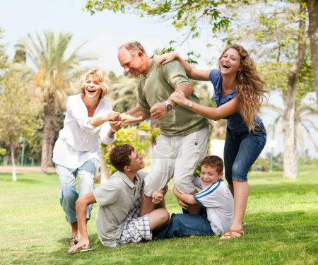 Photo for Grandparents having picnic with grandchildren, extended family portrait - Royalty Free Image