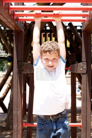 Photo for Boy playing outdoors - Royalty Free Image