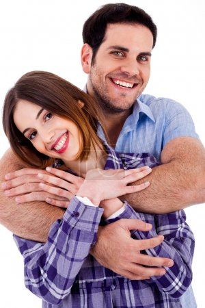 Photo for Closeup portrait of a cute young man hugging his wife from behind - Royalty Free Image