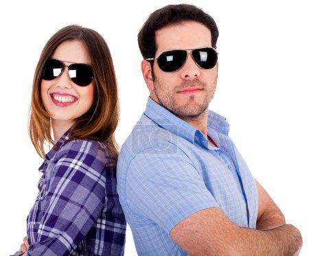 Stylish couple posing back to back