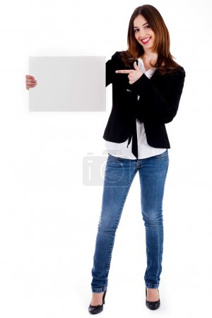 Young lady pointing at blank board