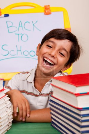 Smiling boy with school books