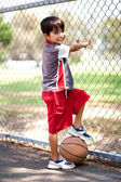 Smart kid posing with basketball