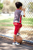 Rear view of young basketball player