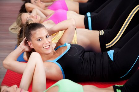 Photo for Group of doing stretching exercise in gym - Royalty Free Image