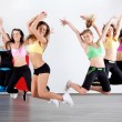 Group of ladies working out in aerobic class...