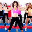 Image of women doing aerobics with dumbbell...
