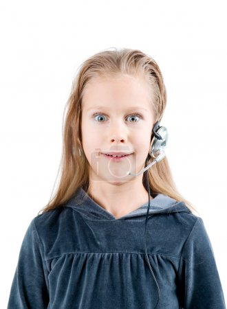 Shocked little girl with headset. W